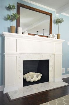 Fireplace Makeover - love this! see this page for more specifics: http://www.younghouselove.com/2013/03/fireplace-makeover-hatching-a-plan/