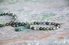 Moss agate crystal mala, 108 Buddhist prayer beads  variegated green via Etsy