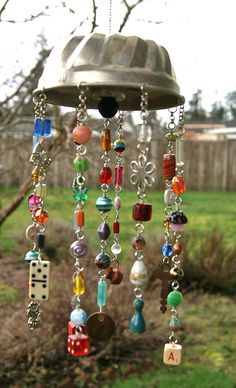 I always have stuff like this, great idea, especially since my youngest loves wind chimes. DIY Unique  Wind chime: Small jello mold, glass beads and baubles, charms and junk!