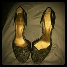 This shoes you could wear for NEW YEAR It's a beautiful shoe  its material glitters very nice you can wear it with a long dress or short mini dress whatever you want to wear with it's just that classy dress shoe I got them in boutique shop the colors are more like copper and gold Michelle D Shoes Heels