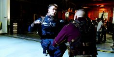 Chris Evans and Georges St-Pierre rehearse for their fight scene aboard the Lemurian Star