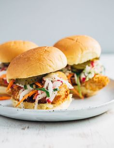 Panko-crusted fried fish sandwiches that are just right for a weeknight at home or a crowd-pleasing feast. Served with a simple radish slaw and bread and butter pickles, these flaky fish sandwiches hit all the right notes.