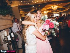 Wedding Album: Dancing with the Stars Pro Lindsay Arnold Shares Photos from Her Big Day | A GOOD CATCH | We have a winner! A thrilled bridesmaid embraced Arnold following her victory.