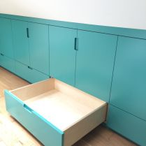 Teal birch plywood eaves storage cabinetry by Karl Rees cabinet maker Eaves Storage, Attic Storage, Attic Rooms, Bespoke Furniture, Cabinet Makers, Furniture Making, Bedroom Decor, Indoor, Modern