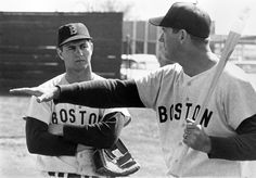Ted Williams instructs Carl Yastrzemski during a 1969 spring training session. (B. Bennett/Getty Images)
