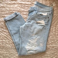 "NWT A&F Boyfriend Ripped Jeans New with tags Abercrombie & Fitch light wash ripped boyfriend jeans with cuff at the bottoms. Size 2R w26. ""Easy fit boyfriend"". Abercrombie & Fitch Pants Straight Leg"