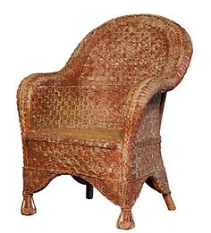 A wicker chair typical of those seen in Ancient Rome, with the curved back it would probably be a barrel chair