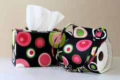 Practical. Pretty. Unique. This is a pattern-coordinated set of one tissue box cover and one toilet paper holder, black with pink & green polka dots. If
