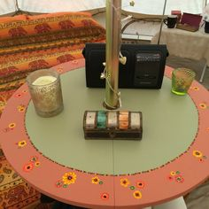 hand painted table, clamps onto the central pole of our Bell tent.  Good use of that pole.