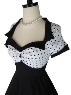 Darling little retro 1950s style pinup sailor dress! Deep open bust in white cotton with black polka dots and ruching in the center. Black notched collar and notched cuffs with 3 black buttons up the bust. Fit and flare full skirt. Belt included. Hidden nylon zipper up the side. The cutest!  No...