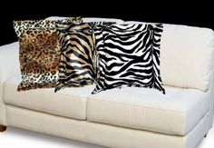 "Zebra Print Cub Pillow  Adorable, Affordable!  Exotic, Elegant and soft to the touch. The animal prints are stunning. The fashion faux fur is approximately 1/8"" pile, for a soft smooth feel. The 2"" Flange adds a touch of style and Elegance. Wonderful addition for any decor from formal to modern. Perfect accent piece in front of a larger pillow. None-removable Cover. Damp Cloth Cleaning.    Approximately: 18"" x 18""  $25.00  SALE $19.00"