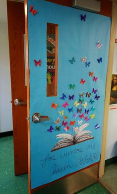 3D butterflies on spring time classroom door - Art Gone Loco - each student decorates 2 identical butterflies, one to glue onto the paper, the other to fold wings up and glue just in the middle.  Flutter away!