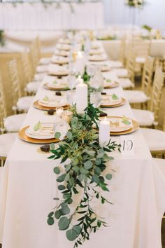 eucalyptus table runner with gold chargers and white pillar candles | Kate Becker Photography | Minneapolis Wedding Photographer