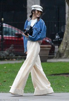 C'est chic: The supermodel exuded Parisian irreverence in a pair of white wie-leg trousers and a Nineties-inspired cropped denim jacket