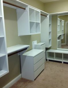 It's done! IKEA Kallax units were mounted to the walls. So much more hanging room with double racks.
