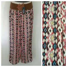 Adorable Boho Pants New with tags Beautiful flowy lightweight palazzo boho chic hippie pants Intricate strechy waist band that laces up like a corset Pink white and blue abstract triangle print pattern Does not have a size tag but would fit a small/medium Pants Wide Leg