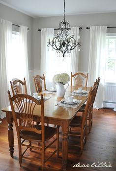 Dear Lillie: My Parent's Dining Room| Benjamin Moore Revere Pewter above the chair rail with white below. Gorgeous chandelier..and the white curtains!