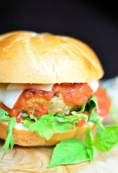 Chicken Parmesan Burger.  Juicy chicken burger cooked with Italian flavors and served with marinara sauce and Mozzarella cheese! from willcookforsmiles.com