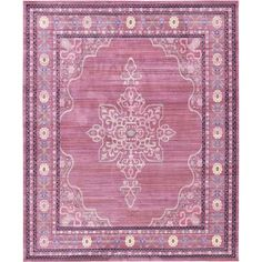 Showcasing a stylish scrolling motif in pink, this timeless rug is perfect setting the foundation for your boho-chic master suite. Just add a collection of patterned pillows and sumptuous throws to your bed, set a shimmering chandelier above, and top your nightstand with a pair of candle lanterns to complete the look.