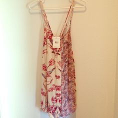 Free People Floral Romper Free People Floral Romper. Cute tie up details on sides. Adjustable straps. Free People Other