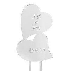 """Spectacular, double-heart cake topper has a sparkling """"Glitter Galore"""" finish that will add dazzle to any wedding cake. Secure it into the cake with the pointed prongs."""