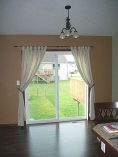 Super easy home update replace those sliding blinds with a curtain sliding door curtain planetlyrics Image collections