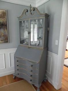 Annie Sloan Chalk Paint in Graphite and Old white ~half and half, with clear and dark wax.  Color for buffet.