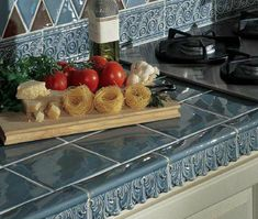 Check Out These 11 Amazing Tile Counters: For a French Look, Blue Tile Kitchen Counter Kitchen Counter Tile, Blue Kitchen Tiles, Tile Counters, Bathroom Countertops, Blue Tiles, Kitchen Flooring, Kitchen Dining, Paris Kitchen, Glass Countertops