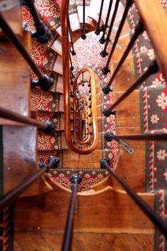 Looking down the tight spiral stairs of the Hotel Astrid in Paris, France by Fred_T