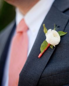 Simple white ranunculus boutonniere // Photo by Robin Nathan Photography, via http://theeverylastdetail.com/modern-elegant-peach-navy-maine-wedding/