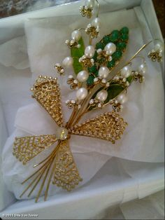 dita's lily of the valley pin. I love this because I love Lily of the Valley!