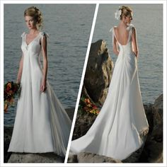 I love this simple wedding gown with a low corsette back