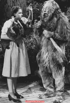 Judy Garland as Dorothy and Bert Lahr who played the Cowardly Lion prepare for another take on the set of The Wizard of Oz.