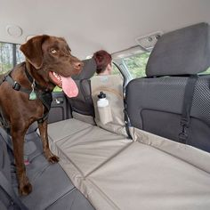 Kurgo Backseat Bridge extends width of backseat for dogs. Keeps your pup out of the front seat ensuring dog safety. Makes comfortable dog bed of back seat. #DogProducts