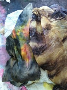 plant dyes-- a scarf gets its gray and brown hues from bark and leaves. Materials pulled from the compost bin, such as coffee grounds, onion skins, and avocado pits, also are used for dyes.