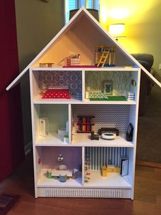 DIY bookshelf dollhouse. Furniture made from household items and from the dollar store. Made by pinner.