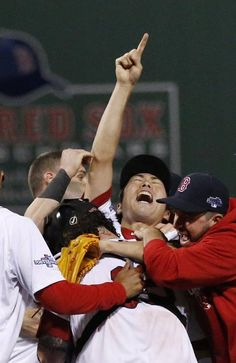 Boston Red Sox relief pitcher Koji Uehara, center, celebrates with teammates after the Red Sox 5-2 beat the Detroit Tigers in Game 6 of the ALCS on Saturday, Oct. 19, 2013 in Boston. Red Sox advance to the World Series. (AP Photo/Tim Donnelly)
