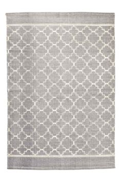 Patterned cotton rug: Large rug in a cotton weave with a print pattern on the front.