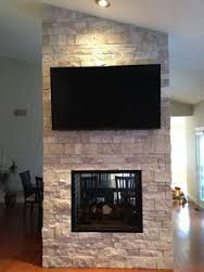 Stunning 2 sided fireplace with an angled ceiling by Surface Design with Durango Splitface! Decor, Fireplace Surrounds, Surface Design, Deco, New Living Room, House Styles, New Homes, Home Decor, Fireplace