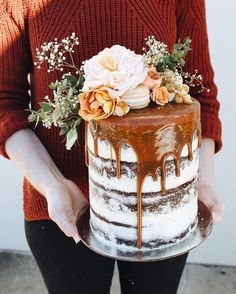 salted caramel drip layer cake with fresh flower topper. Created by Sunshine…