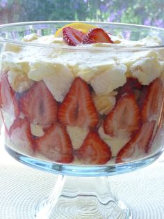 A wonderful quick and easy trifle for Easter, or anytime! Luscious lemon filling plus fresh strawberries and whipped cream are layered with angel food cake cubes in this delicious variation on my Strawberries and Cream Trifle. Tip: Can be made using part lemon curd and part lemon pie filling for a more lemony-tart version. Yum! I like to make this trifle in the morning or a day in advance, and then chill until ready to serve. Can be made in a large trifle bowl, or in individual dessert…