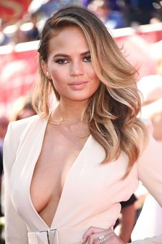 Exfoliating above and below the neck is essential when showing more skin. See all the celebrity beauty secrets now.