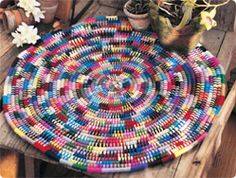 Knit.1 Coiled Puzzle Rug  -- free pattern.  This pattern has been used for placemats, chair seat cushions, and rug.  Solid tone or your own color scheme.