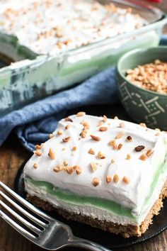 This creamy Pistachio Lush Dessert is one of our family's favorites! Layers of cheesecake, whipped cream, and pistachio pudding are combined with a delicious
