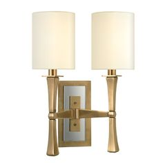 We add unique pizzazz to a sconce whose lines were inspired by the subdued and comfortable style of Danish Modern design. York's gently tapered lamp stem is an elegant contrast to the rectangular back