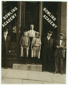 Two of the pinboys are shown in front of a bowling alley in Burlington, Vermont, September 1910. These two worked alongside three other small boys until 10:00 or 11:00 P.M.