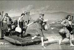 Here's a Normandy Beach landing photo not shown in textbooks: brave women of the Red Cross arriving in 1944 to help the injured troops.