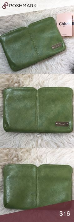 "[Chloe Parfums] zippered clutch w/ free gift Chloe Parfums Zippered Clutch   Color is apple green. Faux leather. Approx. dimensions is 8"" x 5"". Use to carry cosmetics, cellphone, cards, etc. Bonus gift is a Chloe fragrance sample! Chloe Bags Clutches & Wristlets"
