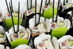 """<p class=""""p1""""> Sesame noodle salad with Asian vegetables, garnished with spicy tuna and California rolls, served in individual take-out containers..."""