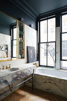 dramatic black and marble bathroom | jenna lyons house tour on coco kelley